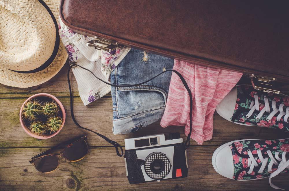 Wie wird ein Koffer gepackt? 5 Tricks um Raum zu sparen